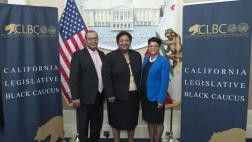Assemblymember Dr. Shirley Weber standing with two others at the Black History Month reception